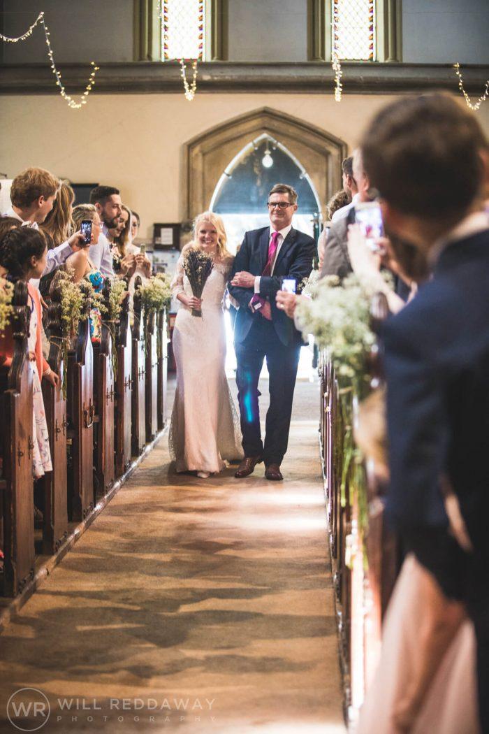 Brunel Manor Wedding| Devon Wedding Photographer | Bride Walking Down The Aisle