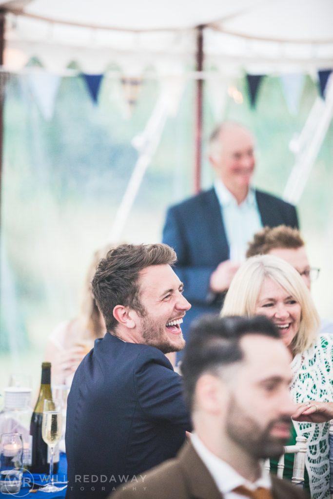 Farringdon Marquee Wedding   Devon Wedding Photographer   Laughing Guest